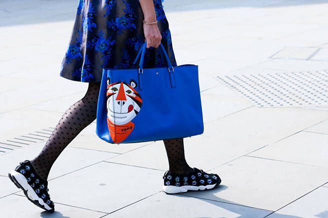 Kellogg's ad purse with Tony the Tiger and cute sneakers at LFW 2015