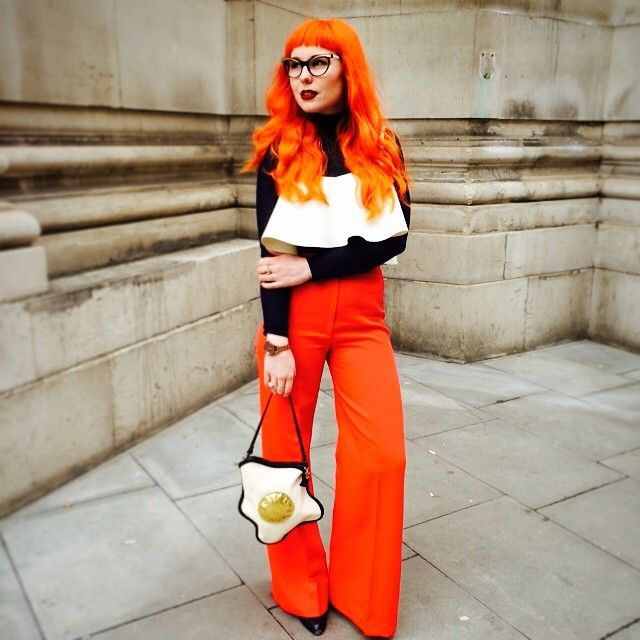Fried eggs purse and bright orange white black outfit at LFW 2015